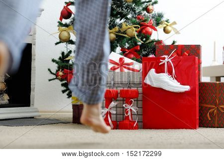 Girl Runs To The Christmas Tree For Gifts.