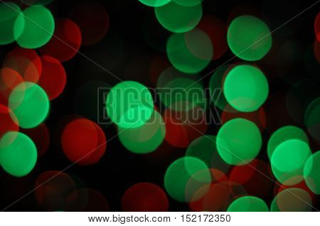 Bokeh lens effect of red and green Christmas colors background
