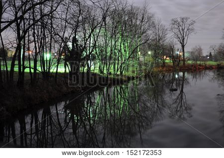 Full moonlight and the reflective glow of lights along the riverbank