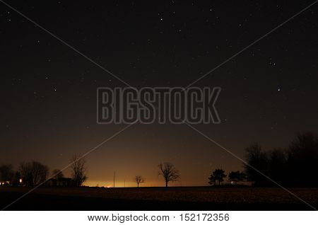 The sky at night above a farm