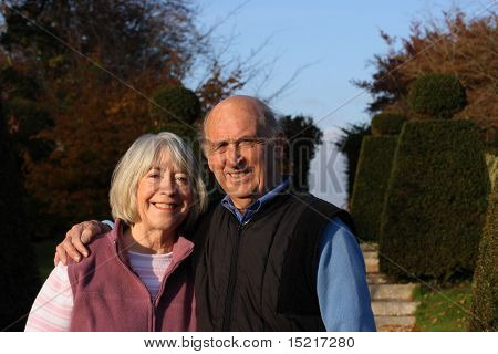 Day out for a senior couple in formal gardens.
