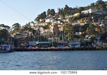 November 11, 2015: Beauty of Naini Lake and Bus stand area early in the morning view form Mall Road, Nainital, Uttarakhand, India. Nainital is a popular hill station in Uttarakhand, named after the Goddess Naina Devi. It also known as the 'Gateway to Kuma