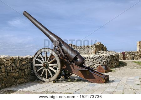 Morella Spain - October 16 2016: An Industrial Artillery Piece at the Morella Castle This canon was Placed in 1954 by the General Captain of Valencia Abriat Miguel Canto.
