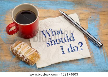 What should I do question - handwriting on a napkin with a cup of coffee