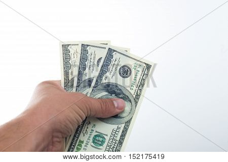 men believes the dollars in hand on white background