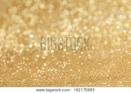 Abstract golden glitter light bokeh holiday party background