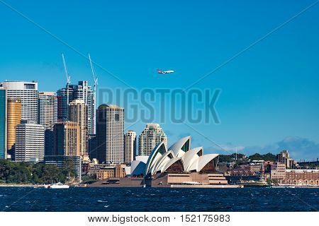 Sydney Opera House And Central Business District With Qantas Plane