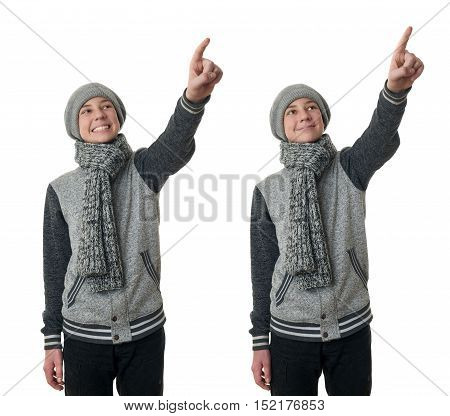 Set of cute teenager boy in gray sweater, hat and scarf pointing up over white isolated background, half body