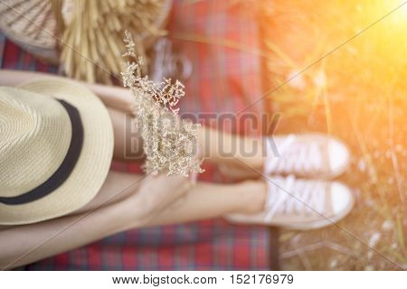 girls legs lying in grass barefoot without shoes soft and select focus