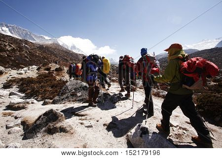 KHUMBU, NEPAL - APRIL 2, 2014: Trekkers heading to Chukkung village near Island peak base camp in Everest region.