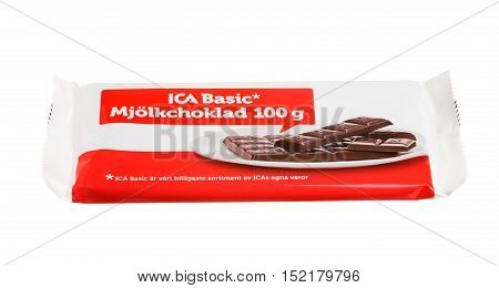 Stockholm, Sweden - March 1, 2014: A package with a bar of 100 g Ica Basic milk chocolate for the Swedish market isolated on white background.