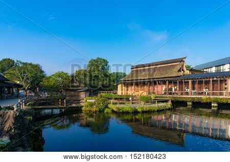 Oshino, Japan - September 2, 2016:Oshino Hakkai, Fuji Five Lakes. Japan countryside landscape of historic thatch roof farmhouses and pond with crystal clear blue water and Mount Fuji