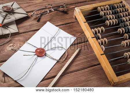Vintage abacus envelopes and letter on wooden table