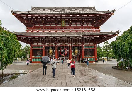 Tokyo Japan - August 29 2016: Hozomon with people taking photos and selfies. Hozomon houses some items of Important Cultural Property and Japanese National Treasure. Senso-ji Asakusa Tokyo Japan