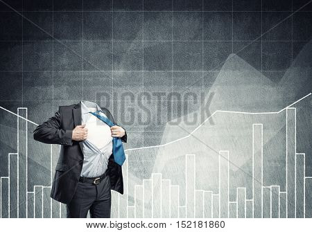 Headless businessman in black suit acting like super hero