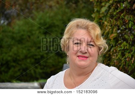 Portrait of smiling senior woman. Senior woman head and shoulders portrait with copy space