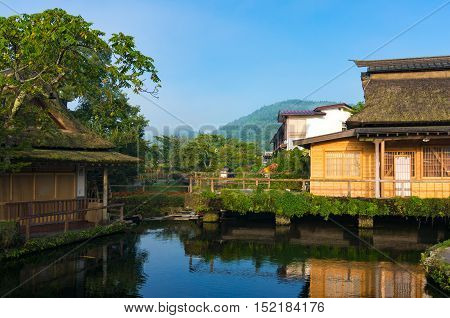 Oshino Hakkai Fuji Five Lakes. Japan countryside landscape of historic thatch roof farmhouses and pond with crystal clear blue water