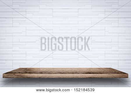 Empty wooden shelf with white brick wall background. For display or montage your products.