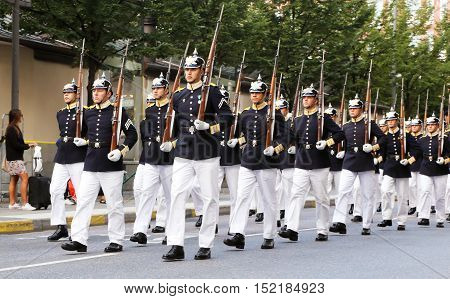 Stockholm, Sweden - August 13, 2013: The Royal guards marching on the street Kungstradgardsgatan.