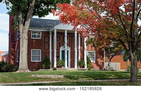 Red Brick Home with Tall Pillars