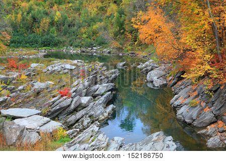 Stream passing through Quechee gorge in autumn time