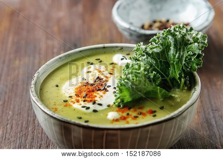 The Classic Pea Puree Soup In The Gray Plate With A Dollop Of So