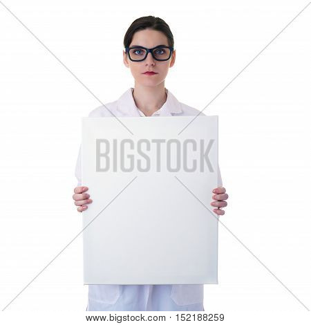 Smiling female doctor assistant scientist in white coat over white isolated background with glasses and white blank board, healthcare, profession, science and medicine concept