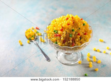 Sweet Boondi - an authentic Indian sweet dish recipe. Gram floor granules deep fird and soaked in sugar syrup.