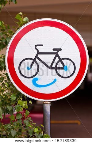 Traffic sign Biking movement is forbidden with a painted smile