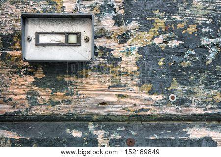 Retro doorbell on old wood door, for backgrounds.