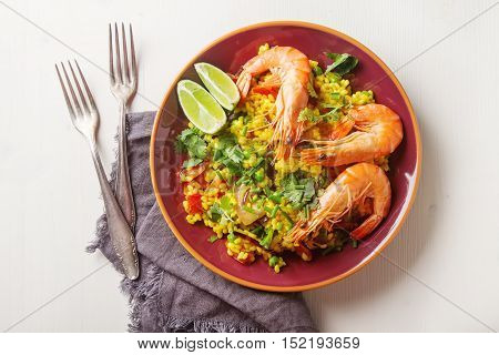 Spanish Paella With Seafood On A Red Cloth Teralke With Lime And