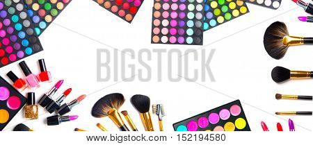 Makeup. Make-up Set Palette with colorful eyeshadows. Various cosmetics Brushes, lipgloss, lipstick, rouge, eyeshadow tints, foundation isolated on a white background. Make up artist tools Wide banner