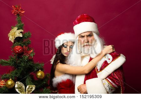 Tender Girl Embraces Santa