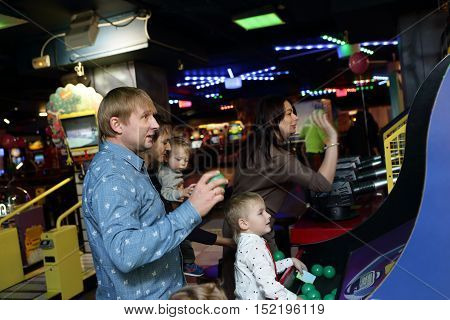 Family playing at an amusement park in the evening