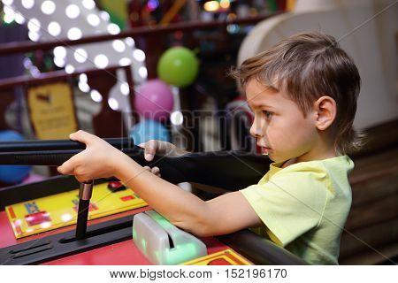 Kid Shooting A Rifle