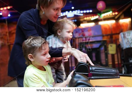 Mother With Sons At Amusement Park