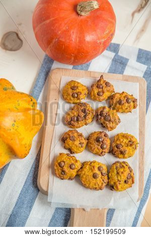 pumpkin chocolate chip cookies on a table