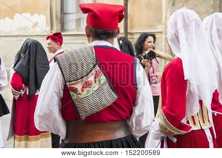 CAGLIARI, ITALY - May 1, 2013: 357th Religious Procession of Sant'Efisio - Sardinia - group of people in traditional Sardinian costume