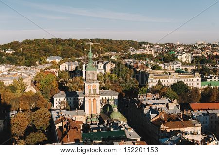 Lviv, Ukraine- 14 october: old city vintage panorama with houses roofs top view. Retro travel industrial photo background. Central European cities