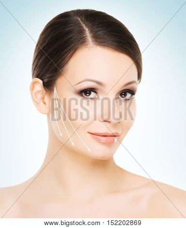 Close-up portrait of beautiful, fresh, healthy and sensual girl with arrows on her face. Medicine, face lifting treatment, spa and skin care concept.