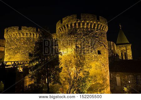 Fortress tower, gate and wooden bridge at night, Kalemegdan, Belgrade, Serbia