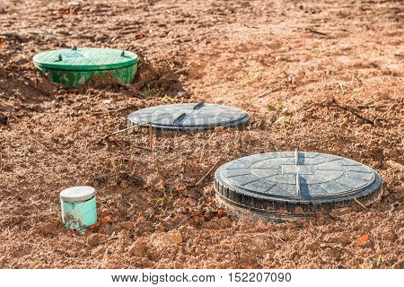 close up on three septic tanks for domestic wastewater treatment