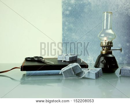 christmas. oil lamp with books. space for text