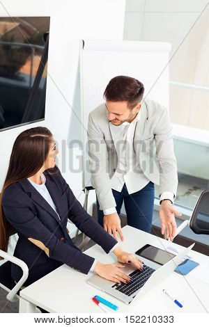 Young beautiful business people in modern office