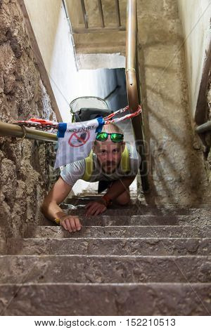 A man violates the rules and goes into the restricted area on the steep stairs