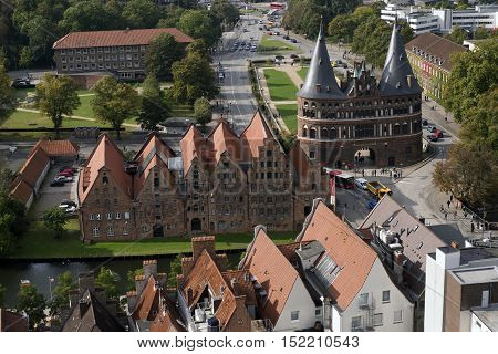 LUBECK GERMANY - OCTOBER 13 2016: Aerial view of Lubeck with the Holsten gate and Salzspeicher (salt storehouses). Lubeck is listed by UNESCO as a World Heritage Site.