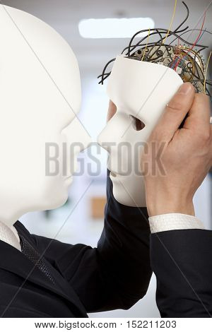 Cyborg, clone, robot and artificial man concept -  Businessmen android robot holds clone white face mask