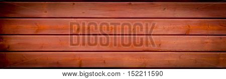 wooden panoramic banner background with a vignette and off center highlight with copy space and texture for your text
