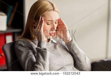 business, stress and people concept - close up of businesswoman feeling sick or suffering from headache at office work