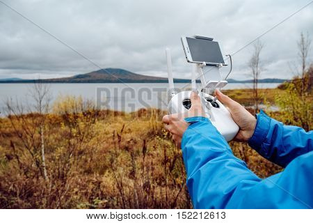 Remote control of a drone flying over a lake